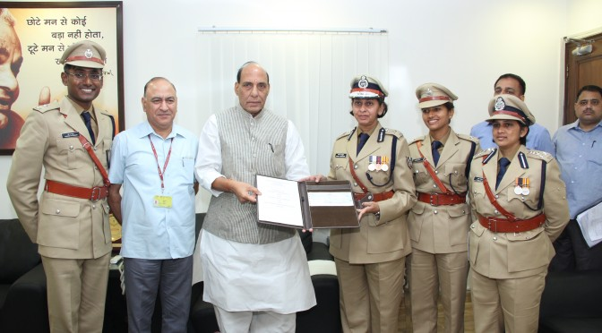 Director,National Police Academy  presented a cheque to the HM as contribution to PM Relief Fund (29 sept. 2014).