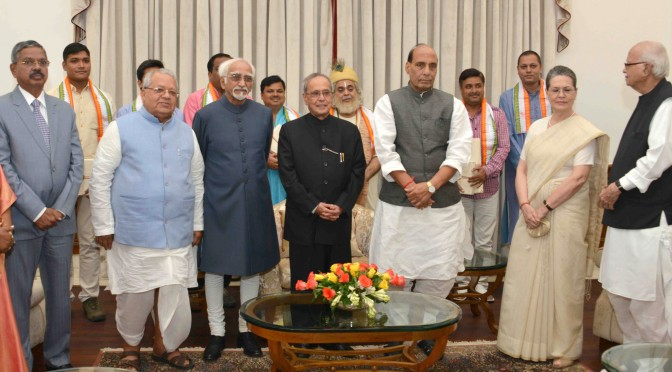 The President, Shri Pranab Mukherjee with the artists after witnessing the Mono Act on 'Kabir' by Shri Shekhar Sen, at Rashtrapati Bhavan, in New Delhi on July 25, 2015. 	The Vice President, Shri Mohd. Hamid Ansari, the Union Home Minister, Shri Rajnath Singh, the Union Minister for Micro, Small and Medium Enterprises, Shri Kalraj Mishra and other dignitaries are also seen.