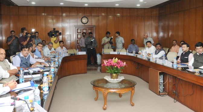 The Union Home Minister, Shri Rajnath Singh chaired a meeting on 'Security arrangement available to various private companies engaged in iron ore and dolomite mining in Gadchiroli and Gondia districts of Maharashtra', in New Delhi on August 27, 2015.  The Union Minister for Road Transport & Highways and Shipping, Shri Nitin Gadkari, the Chief Minister of Maharashtra, Shri Devendra Fadnavis, the Minister of State for Chemicals & Fertilizers, Shri Hansraj Gangaram Ahir, the Union Home Secretary, Shri L.C. Goyal and Senior Officials of respective Union Ministries are also seen.