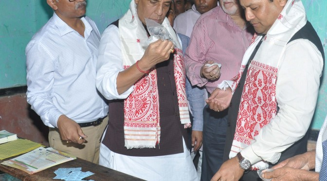 The Union Home Minister, Shri Rajnath Singh inspecting the relive material at flood relive camp, at Morigaon District of Assam on July 30, 2016. The Chief Minister of Assam, Shri Sarbananda Sonowal is also seen.