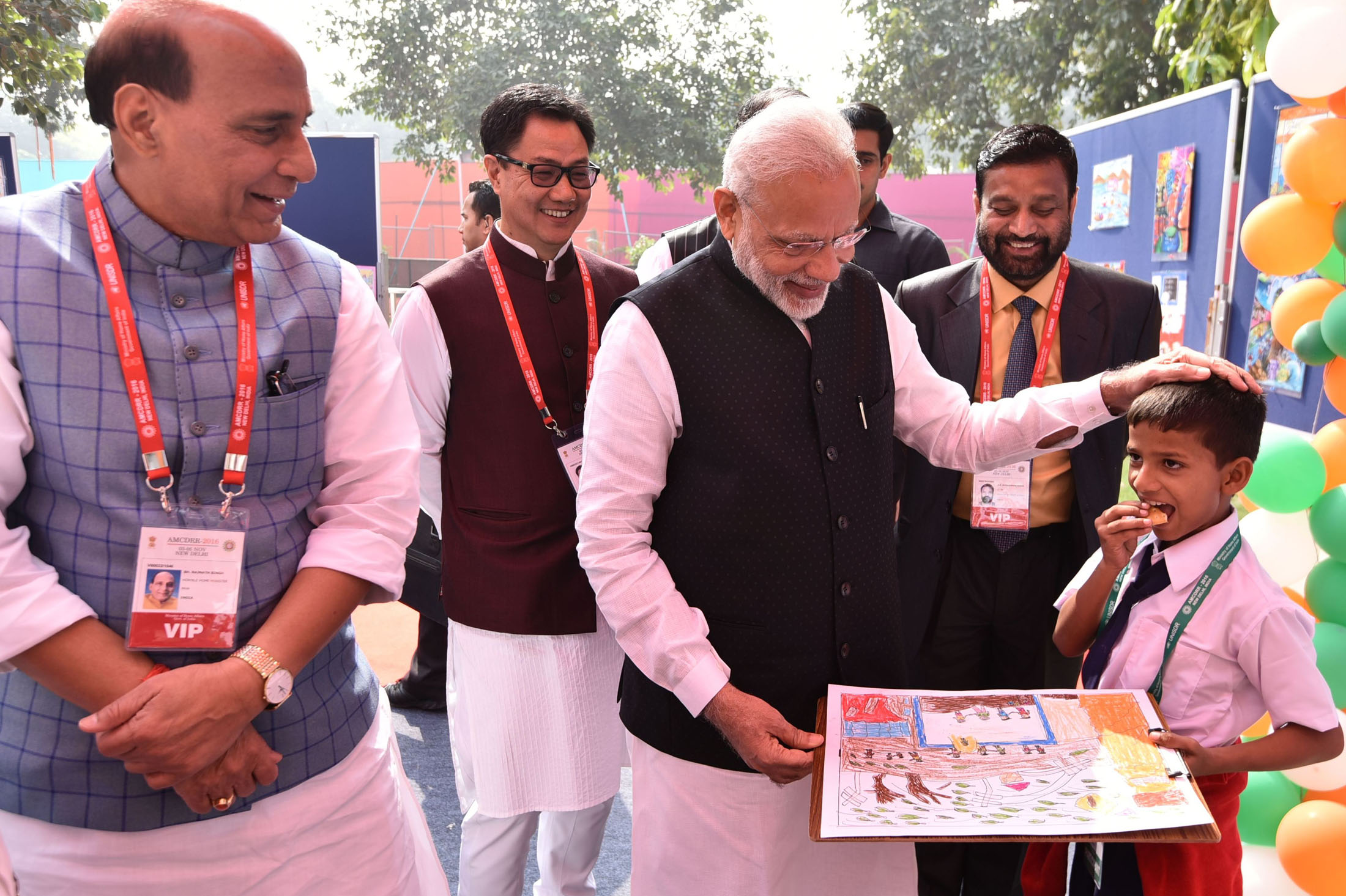 The Prime Minister, Shri Narendra Modi and Home Minister Shri Rajnath Singh with the participants of Painting Contest at the Asian Ministerial Conference on Disaster Risk Reduction, in New Delhi on November 03, 2016. 	The Minister of State for Home Affairs, Shri Kiren Rijiju also seen.