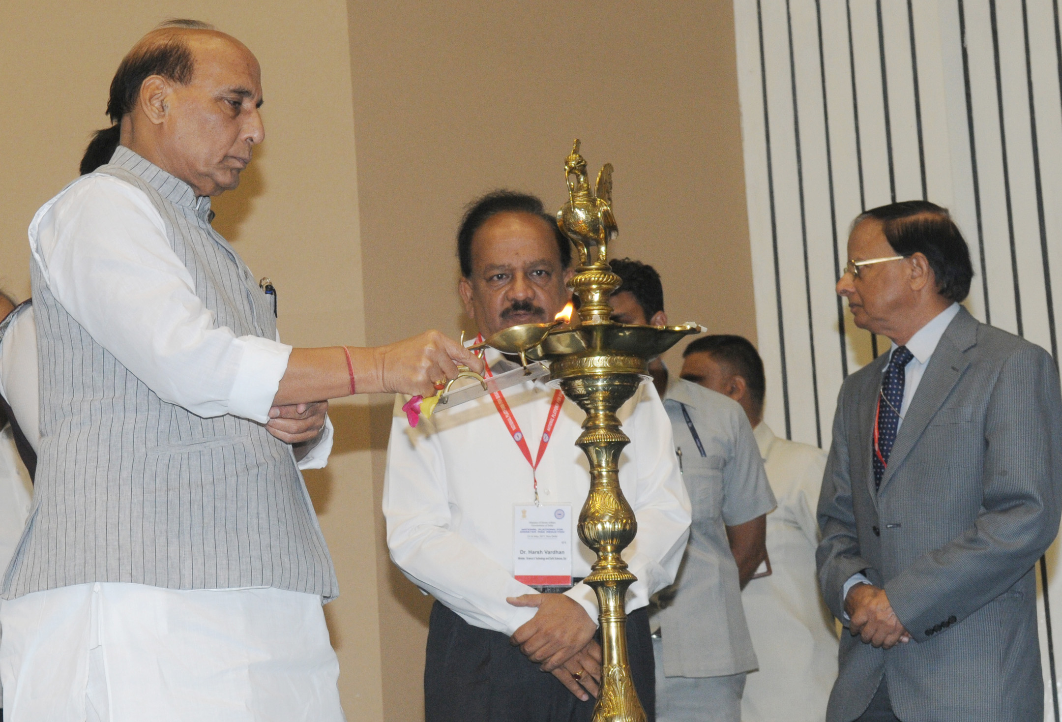 The Union Home Minister, Shri Rajnath Singh lighting the lamp to inaugurate the second meeting of the National Platform for Disaster Risk Reduction (NPDRR), in New Delhi on May 15, 2017. 	The Union Minister for Science & Technology and Earth Sciences, Dr. Harsh Vardhan and the Additional Principal Secretary to the Prime Minister, Dr. P.K. Mishra are also seen.