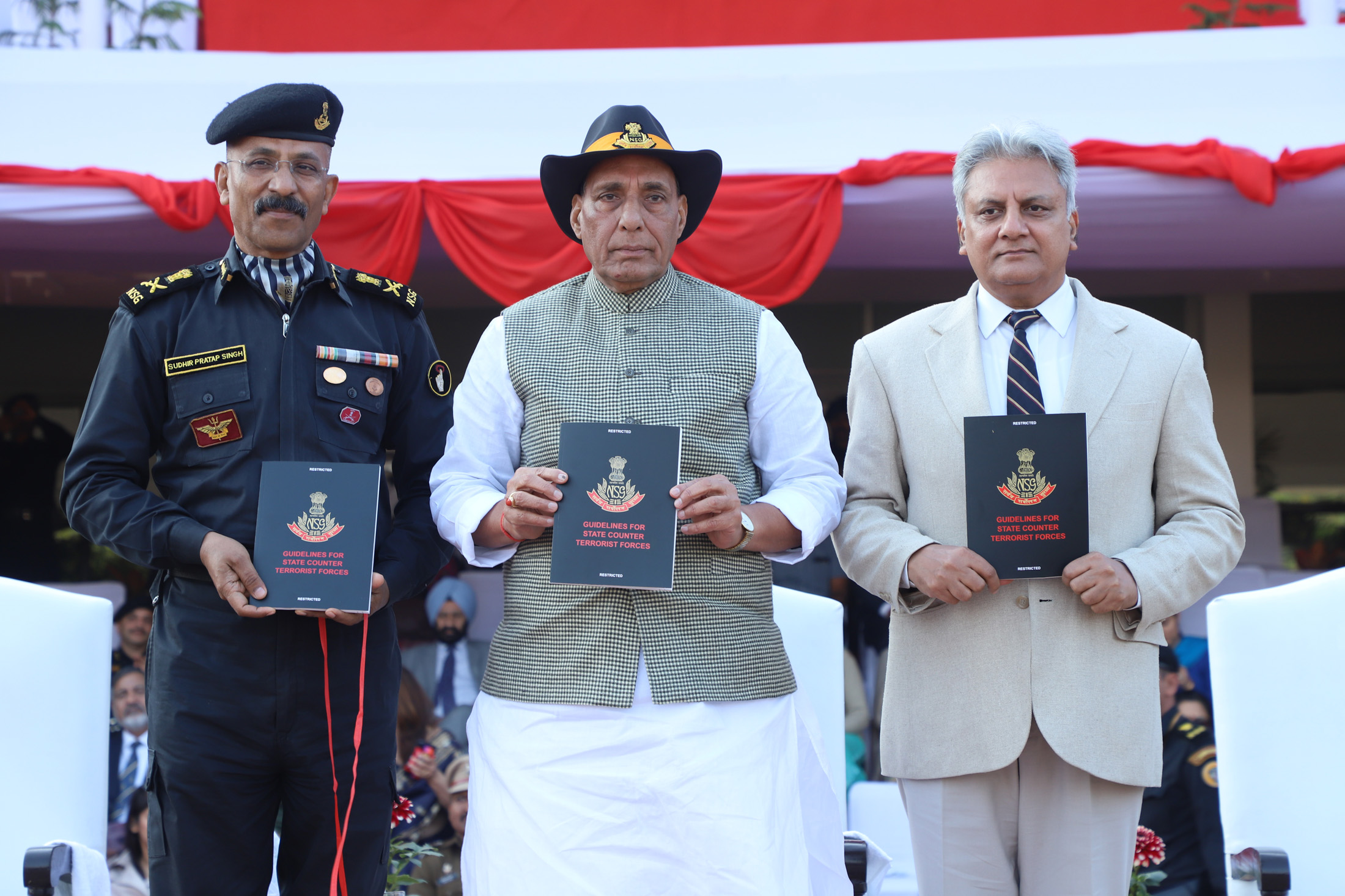 The Union Home Minister, Shri Rajnath Singh releasing a compendium, during the Closing Ceremony of the 8th All India Police Commando Competition, at Manesar, Gurugram, in Haryana on January 20, 2018.  The Director General, NSG, Shri Sudhir Pratap Singh and the Director, IB, Shri Rajiv Jain are also seen.