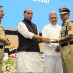 The Union Home Minister, Shri Rajnath Singh presenting the awards, at the Investiture Ceremony of Border Security Force (BSF), in New Delhi on May 22, 2018. The DG, BSF, Shri K.K. Sharma and the Director IB, Shri Rajiv Jain are also seen.