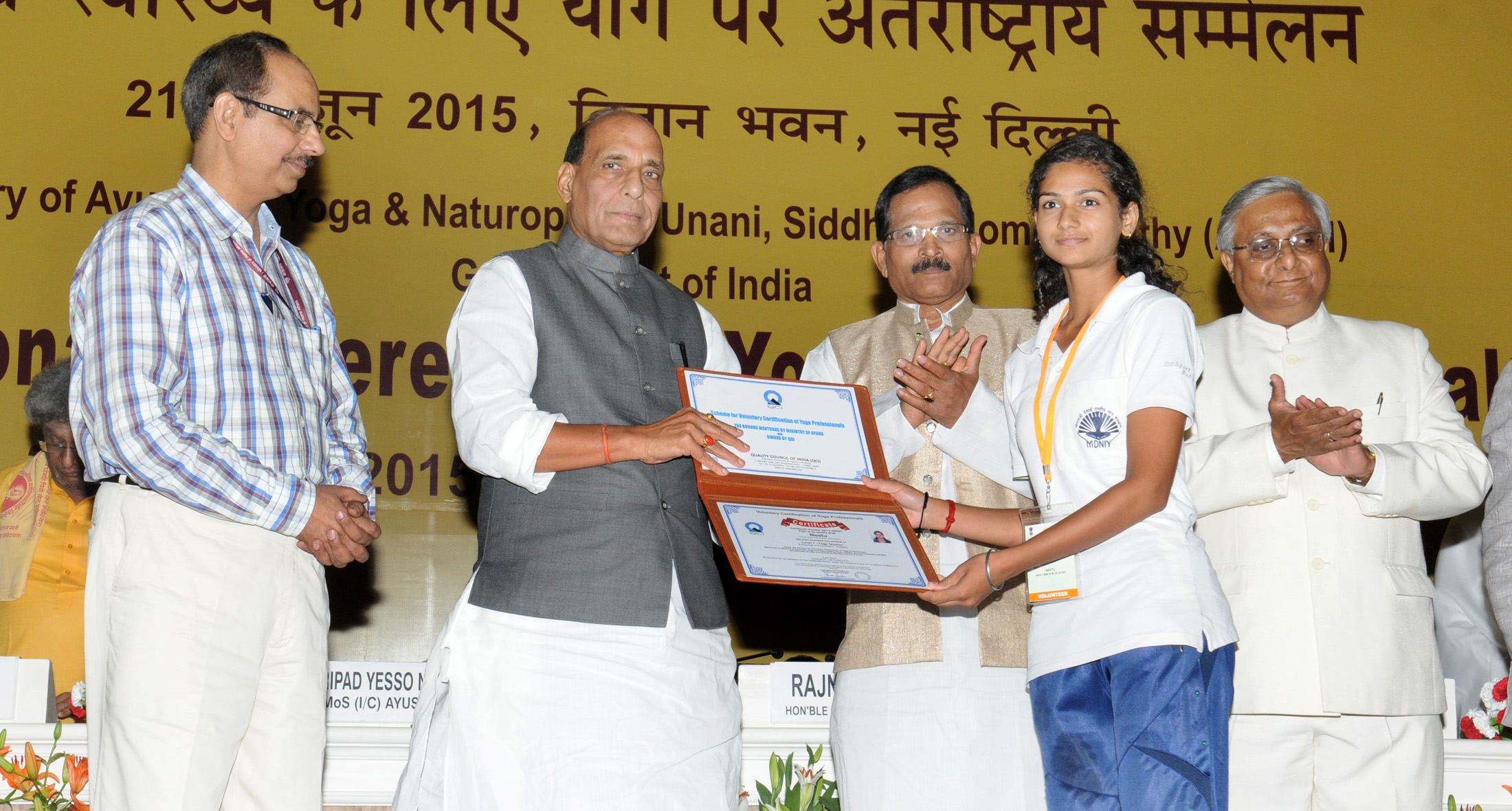 The Union Home Minister, Shri Rajnath Singh presenting the Voluntary Certification of Yoga Professionals, at the International Conference on Yoga for Holistic Health, in New Delhi on June 22, 2015. The Minister of State for AYUSH (Independent Charge) and Health & Family Welfare, Shri Shripad Yesso Naik and the Secretary, Ministry of AYUSH, Shri Nilanjan Sanyal are also seen.
