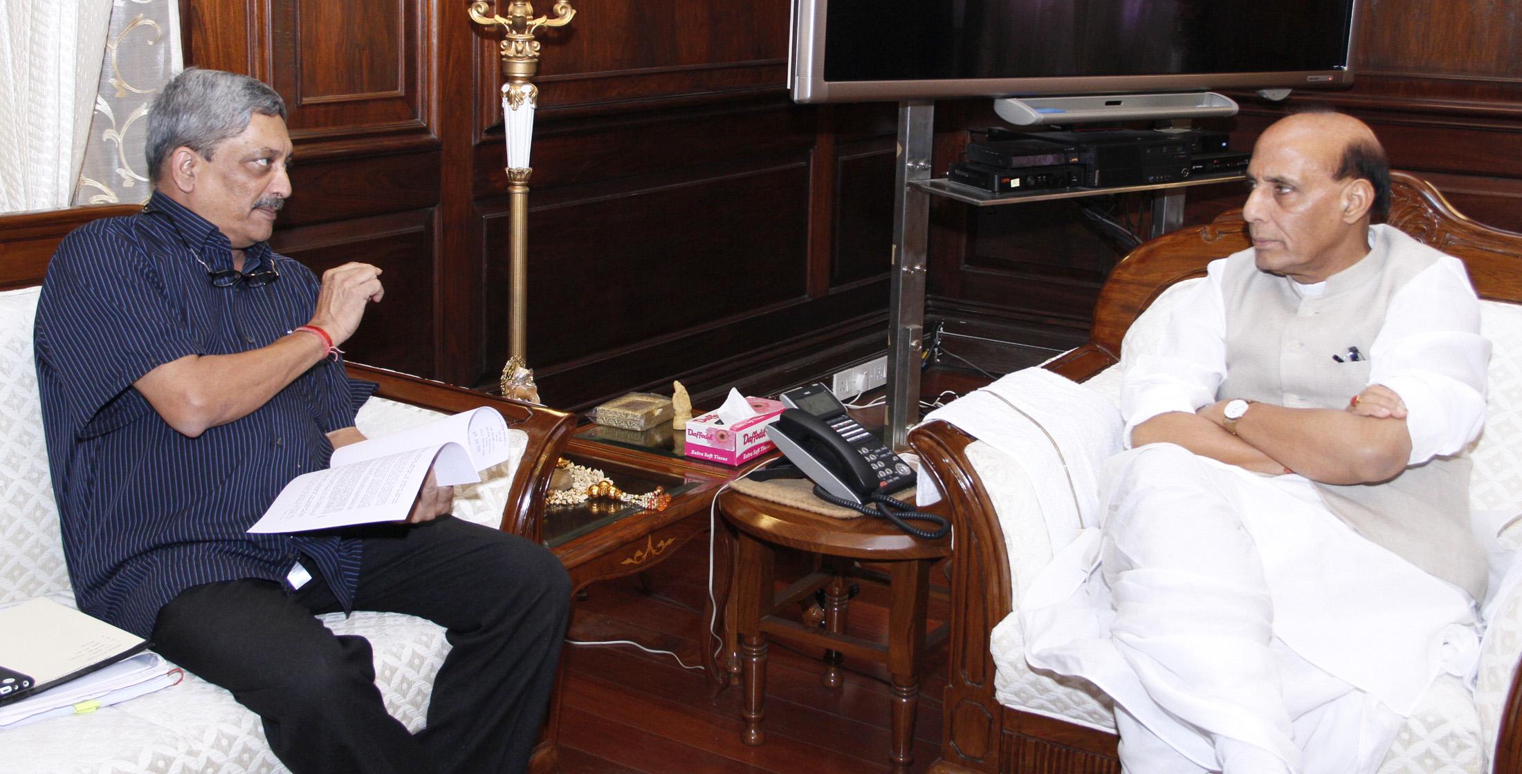 The Union Minister for Defence, Shri Manohar Parrikar calling on the Union Home Minister, Shri Rajnath Singh, in New Delhi on June 29, 2015.