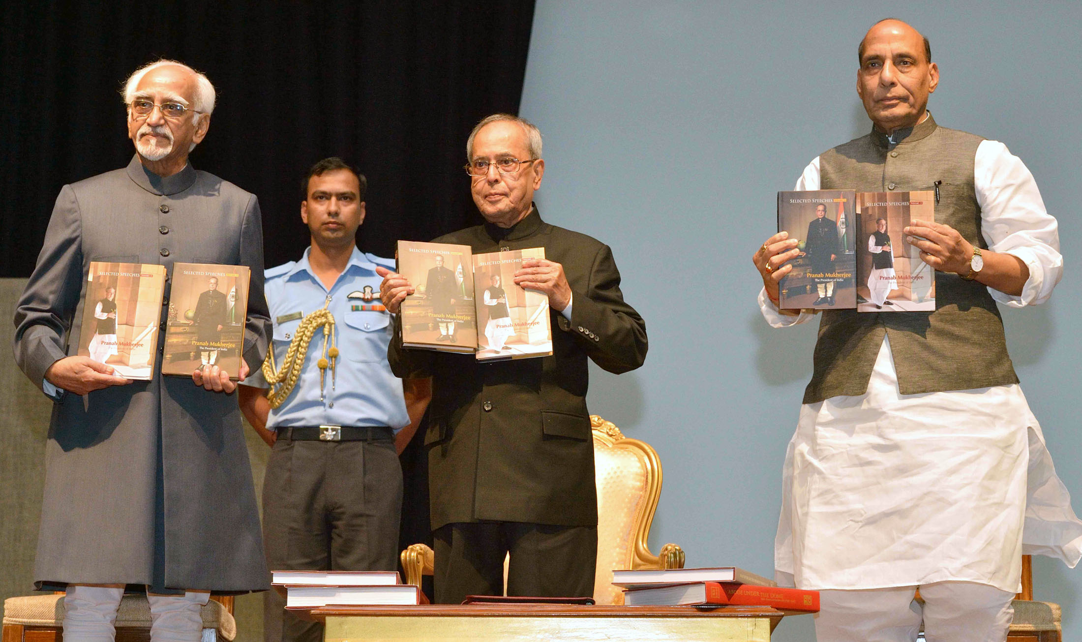 """The President, Shri Pranab Mukherjee and the Union Home Minister, Shri Rajnath Singh during the release of 2 volumes of the book entitled """"Selected Speeches of the President"""", by the Vice President, Shri Mohd. Hamid Ansari, at Rashtrapati Bhavan, in New Delhi on July 24, 2015."""