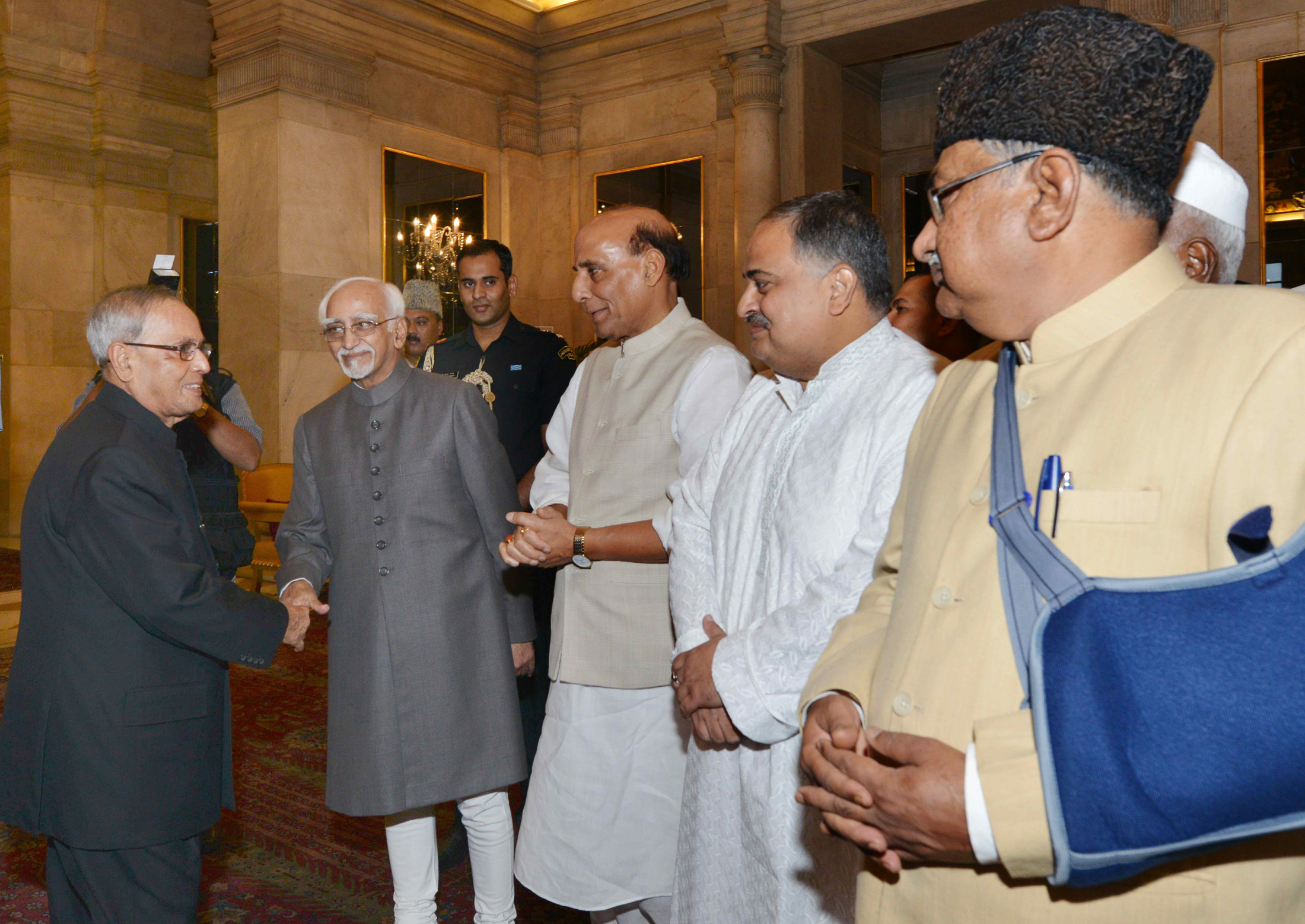The President, Shri Pranab Mukherjee meeting the Vice President, Shri Mohd. Hamid Ansari, at an Iftar party, hosted by him, at Rashtrapati Bhavan, in New Delhi on July 15, 2015. The Union Home Minister, Shri Rajnath Singh dignitaries are also seen.