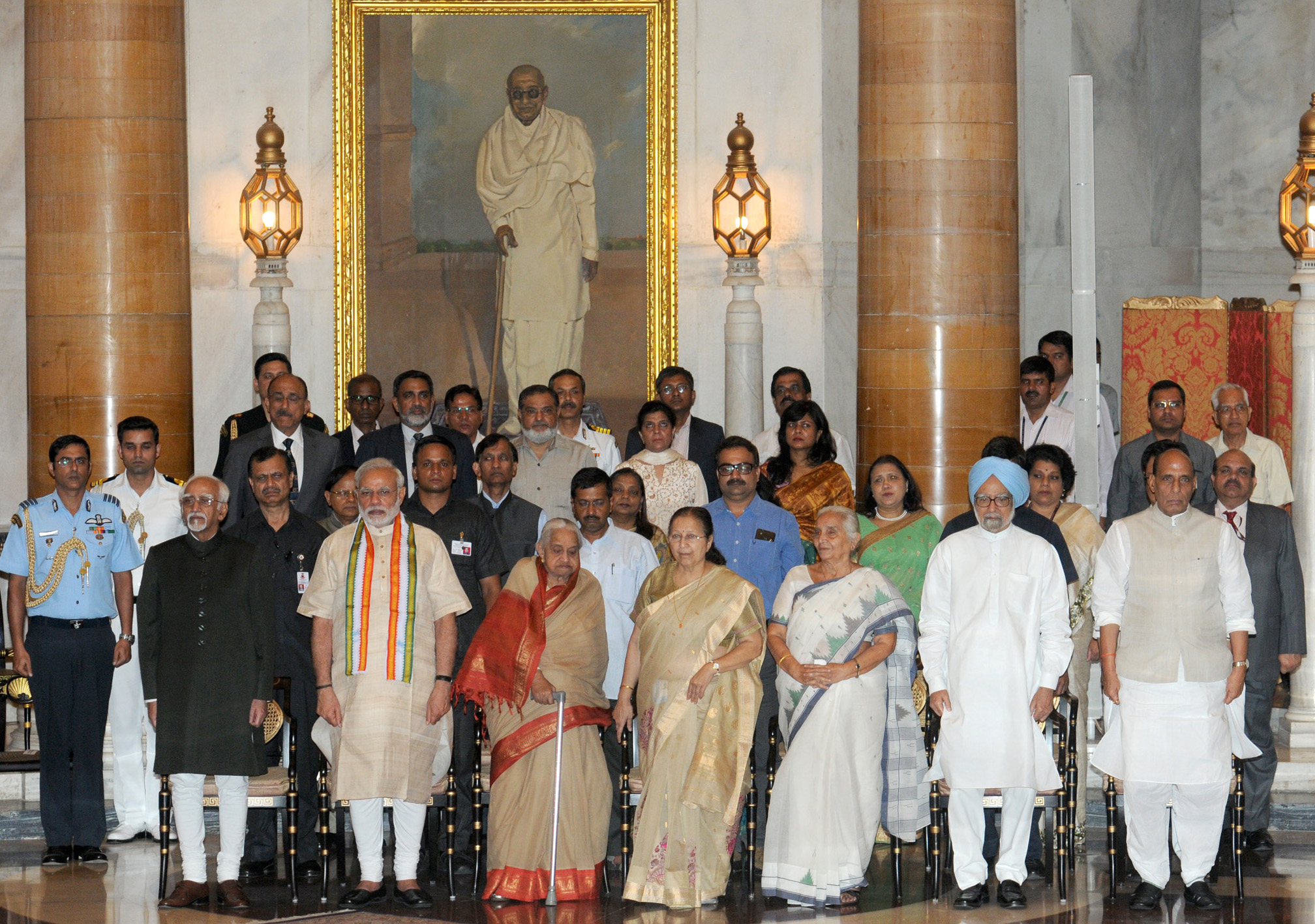 The Prime Minister, Shri Narendra Modi at the 'At Home' reception for Freedom Fighters, hosted by the President, Shri Pranab Mukherjee, at Rashtrapati Bhavan, in New Delhi on August 09, 2015. The Vice President, Shri Mohd. Hamid Ansari, the former Prime Minister, Dr. Manmohan Singh, the Speaker, Lok Sabha, Smt. Sumitra Mahajan, the Union Home Minister, Shri Rajnath Singh, the Chief Minister of Delhi, Shri Arvind Kejriwal and other dignitaries are also seen.