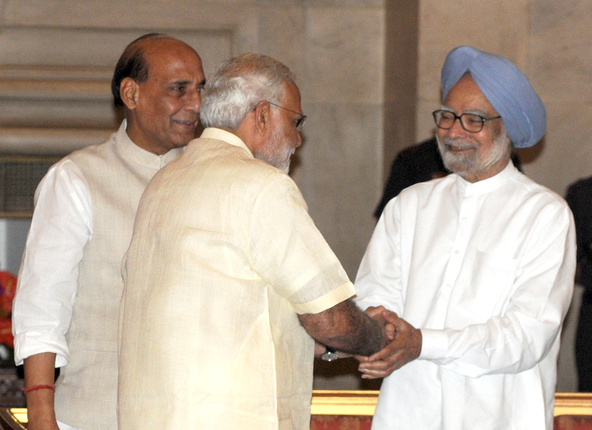 The Prime Minister, Shri Narendra Modi with the former Prime Minister, Dr. Manmohan Singh at the 'At Home' function, organised on the occasion of 69th Independence Day, at Rashtrapati Bhavan, in Delhi on August 15, 2015. The Union Home Minister, Shri Rajnath Singh is also seen.