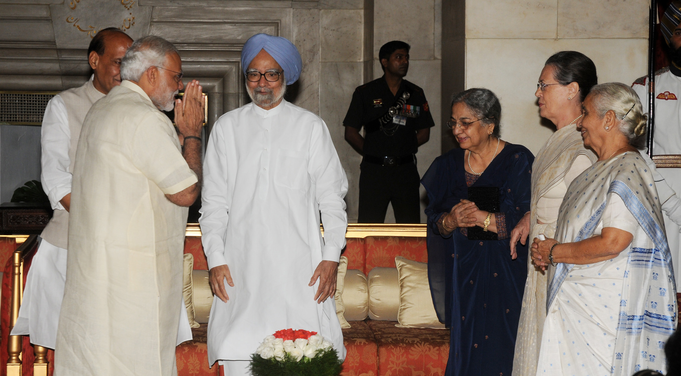 The Prime Minister, Shri Narendra Modi with the former Prime Minister, Dr. Manmohan Singh at the 'At Home' function, organised on the occasion of 69th Independence Day, at Rashtrapati Bhavan, in Delhi on August 15, 2015. The Union Home Minister, Shri Rajnath Singh and other dignitaries are also seen.