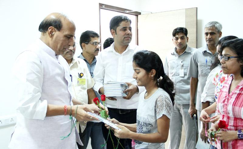 "A Delhi University girl student tying ""Rakhi"" to the Union Home Minister, Shri Rajnath Singh, in New Delhi on August 26, 2015."