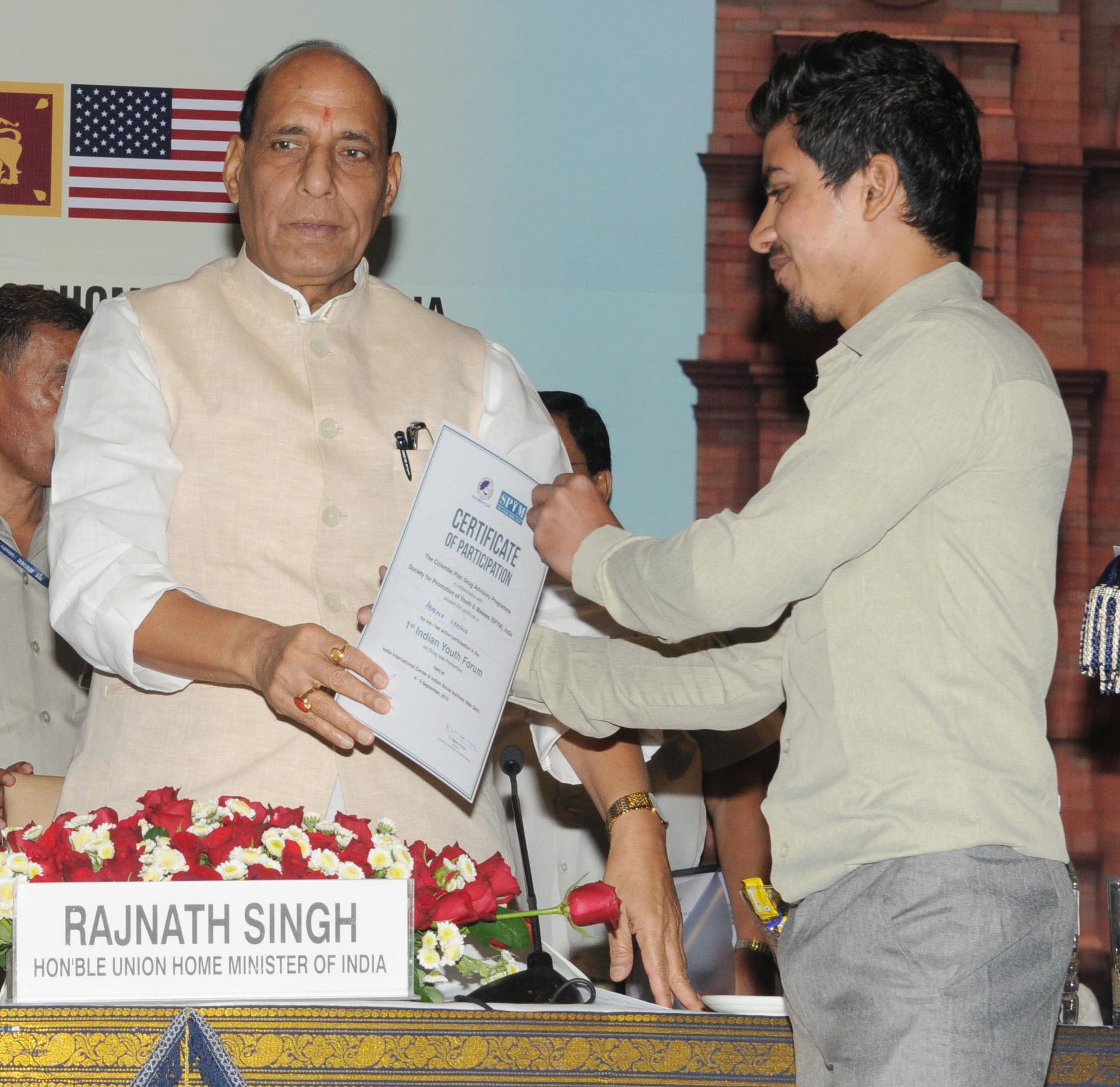 The Union Home Minister, Shri Rajnath Singh distributing the certificate to a youth representative at the inauguration of a three-day workshop on Sub-Regional Drug 'Focal Point Meeting and DDR Expert Group Consultation, South Asia under Colombo Plan Drug Advisory Programme', in New Delhi on September 09, 2015.