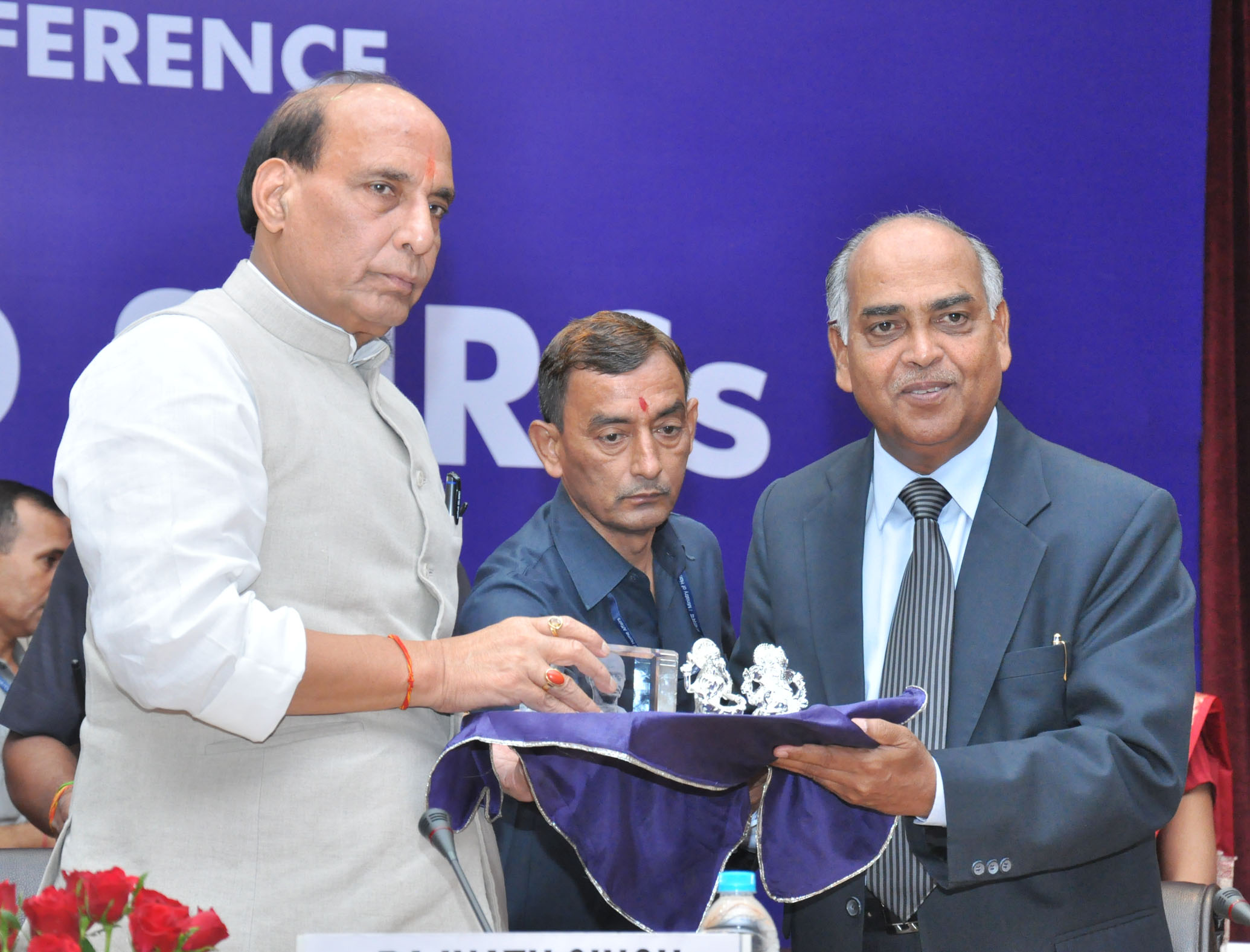 The Justice Cyriac Joseph, Chairperson, National Human Rights Commission (NHRC) presenting a memento to the Union Home Minister, Shri Rajnath Singh, at the inauguration of a Conference of the National Human Rights Commission (NHRC) and the State Human Rights Commissions (SHRCs), in New Delhi on September 18, 2015.