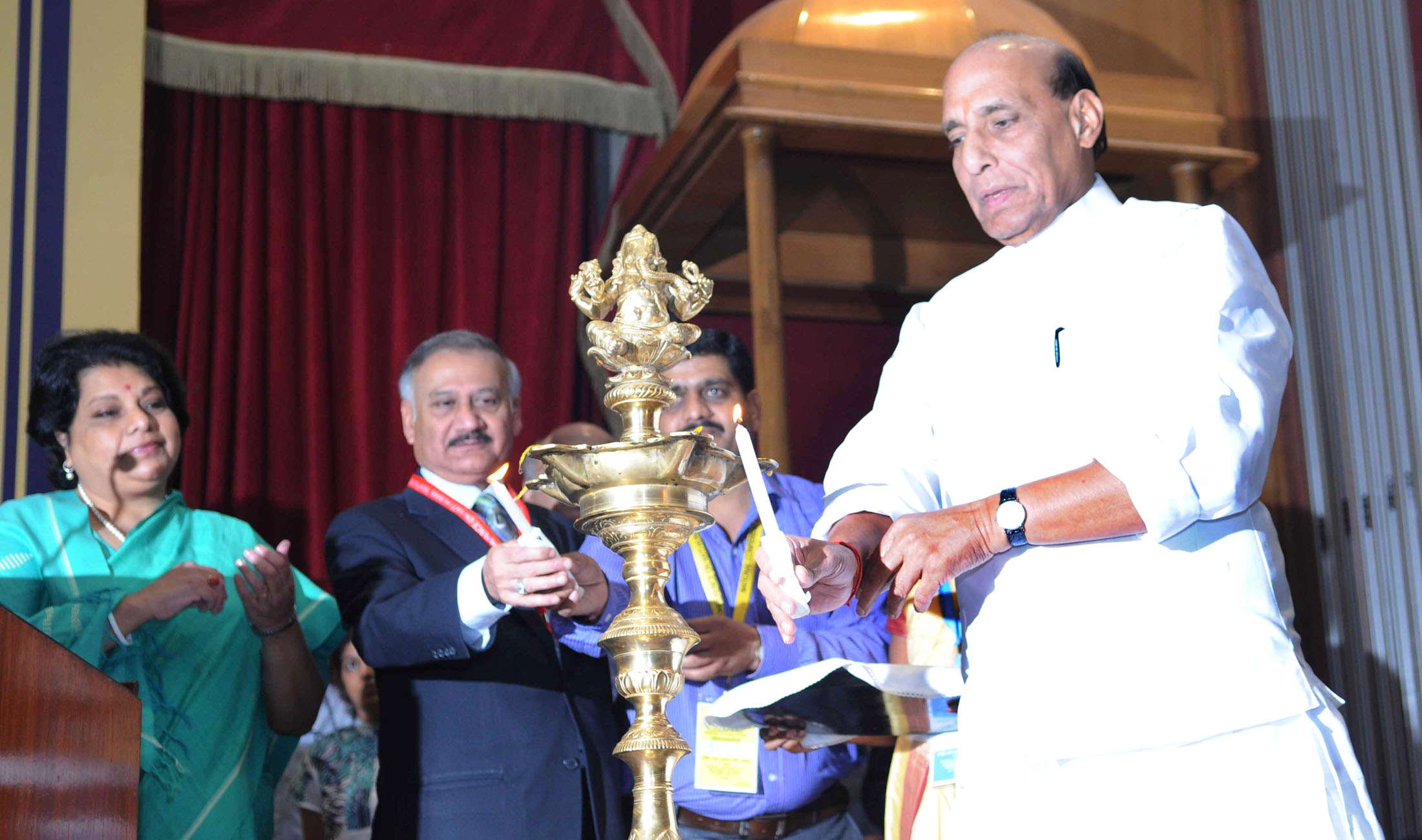 The Union Home Minister, Shri Rajnath Singh lighting the lamp to inaugurate the National Conference on Anti Human Trafficking, in New Delhi on October 07, 2015. The Director, CBI, Shri Anil Kumar Sinha is also seen.