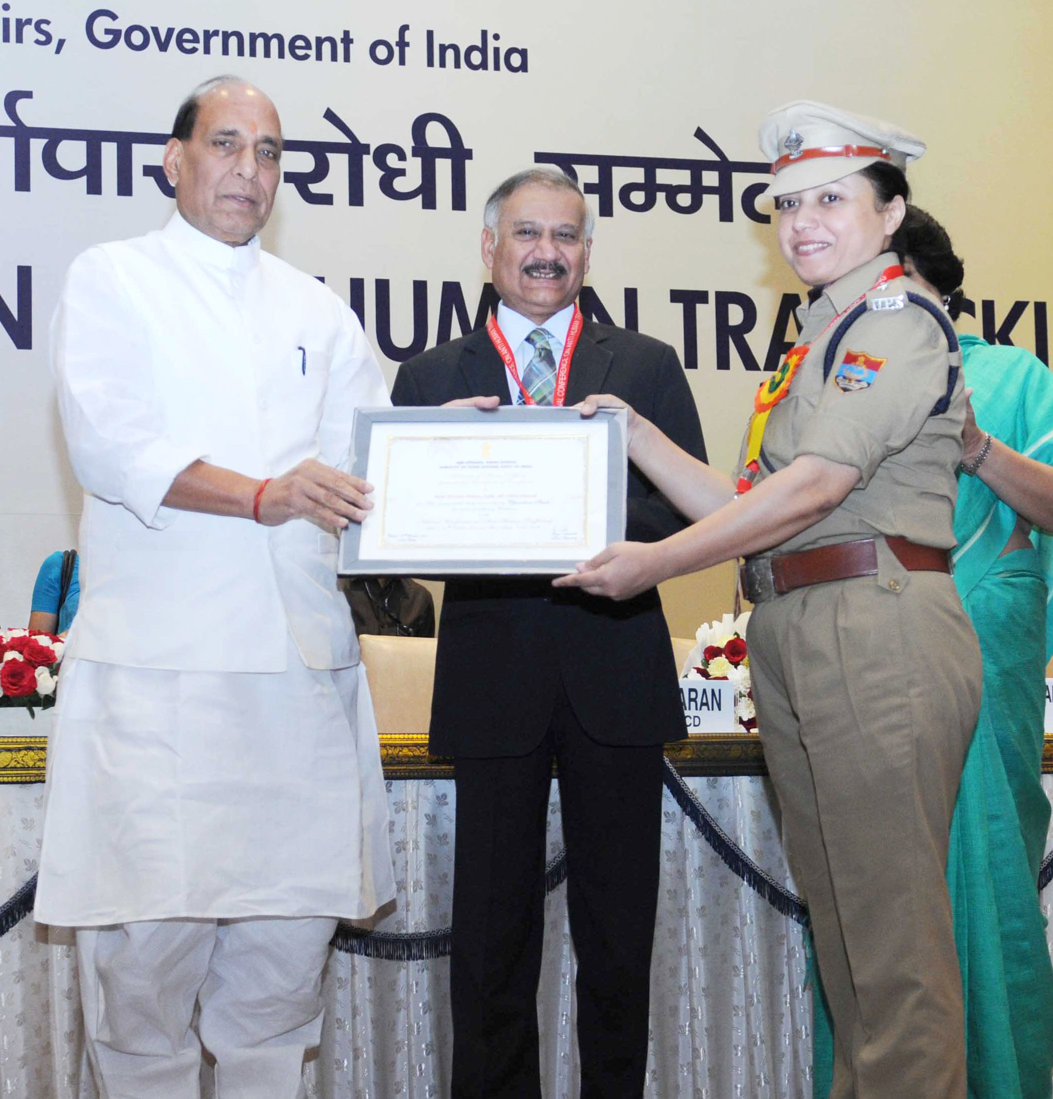 The Union Home Minister, Shri Rajnath Singh presented the certificates to top performers of 'Operation Smile', at the inauguration of the National Conference on Anti Human Trafficking, in New Delhi on October 07, 2015. The Director, CBI, Shri Anil Kumar Sinha is also seen.
