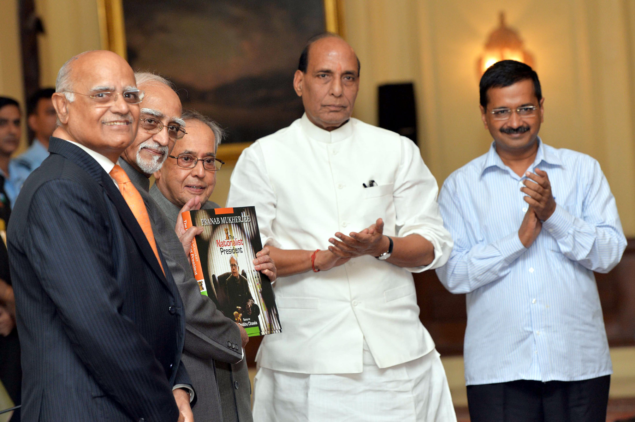 The President, Shri Pranab Mukherjee receiving the first copy of the Coffee Table Book 'The Nationalist President Pranab Mukherjee', edited by Shri Prabhu Chawla, from the Vice President, Shri Mohd. Hamid Ansari, at Rashtrapati Bhavan, in New Delhi on October 07, 2015. The Union Home Minister, Shri Rajnath Singh and the Chief Minister of Delhi, Shri Arvind Kejriwal are also seen.