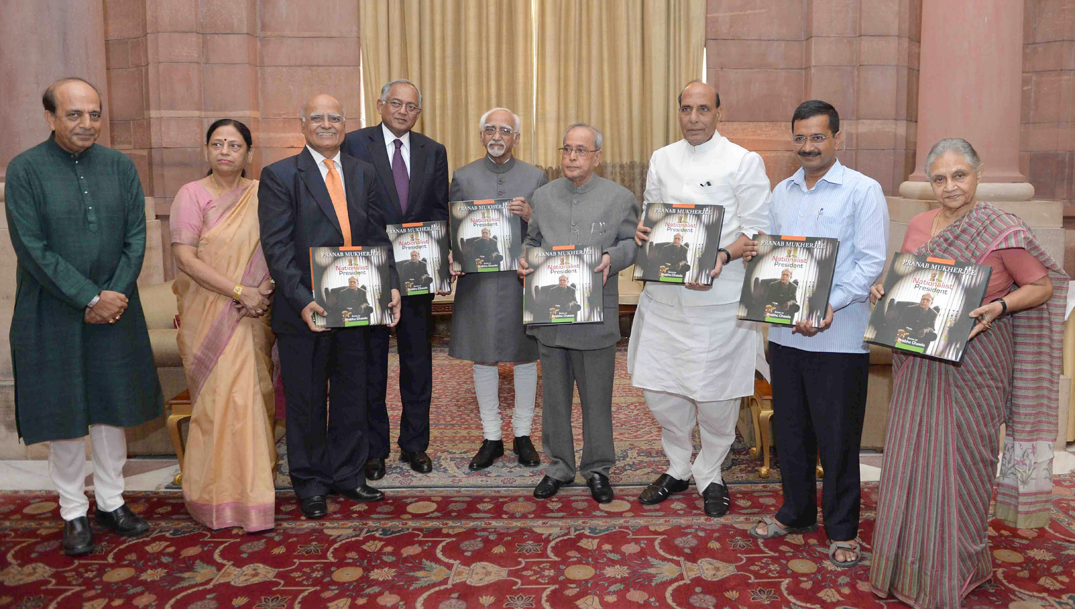 The President, Shri Pranab Mukherjee received the first copy of the Coffee Table Book 'The Nationalist President Pranab Mukherjee', edited by Shri Prabhu Chawla, at Rashtrapati Bhavan, in New Delhi on October 07, 2015. The Vice President, Shri Mohd. Hamid Ansari, the Union Home Minister, Shri Rajnath Singh, the Chief Minister of Delhi, Shri Arvind Kejriwal and other dignitaries are also seen.