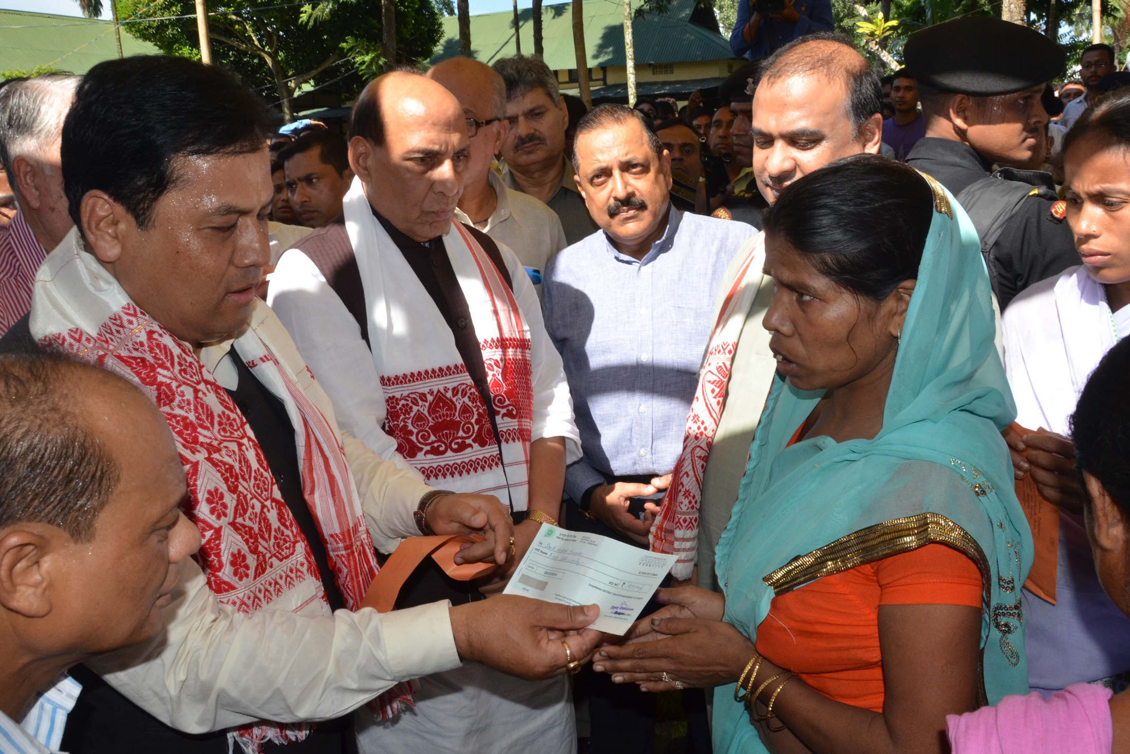The Union Home Minister, Shri Rajnath Singh at the flood relive camp, at Morigaon District of Assam on July 30, 2016. The Chief Minister of Assam, Shri Sarbananda Sonowal and the Minister of State for Development of North Eastern Region (I/C), Prime Minister's Office, Personnel, Public Grievances & Pensions, Atomic Energy and Space, Dr. Jitendra Singh are also seen.