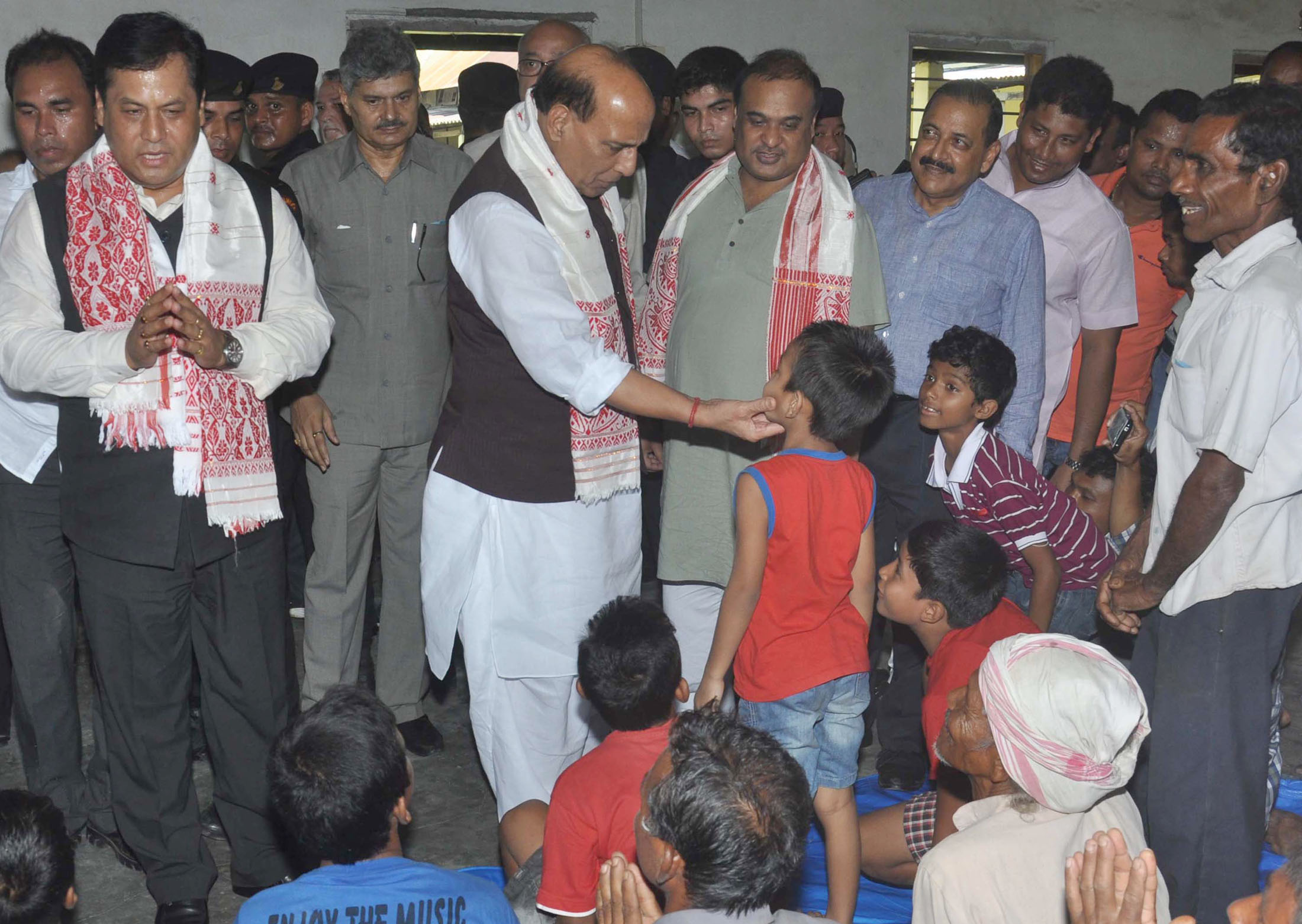The Union Home Minister, Shri Rajnath Singh visiting the flood relive camp, at Morigaon, District of Assam on July 30, 2016. The Chief Minister of Assam, Shri Sarbananda Sonowal and the Minister of State for Development of North Eastern Region (I/C), Prime Minister's Office, Personnel, Public Grievances & Pensions, Atomic Energy and Space, Dr. Jitendra Singh are also seen.
