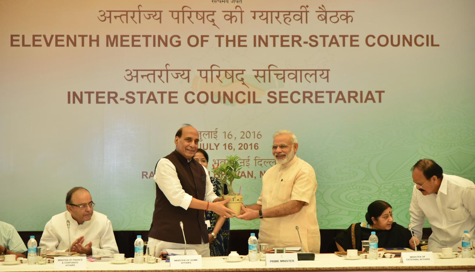 The Union Home Minister, Shri Rajnath Singh presenting a Bonsai plant to Prime Minister, Shri Narendra Modi, at the eleventh Inter-State Council Meeting, in New Delhi on July 16, 2016.