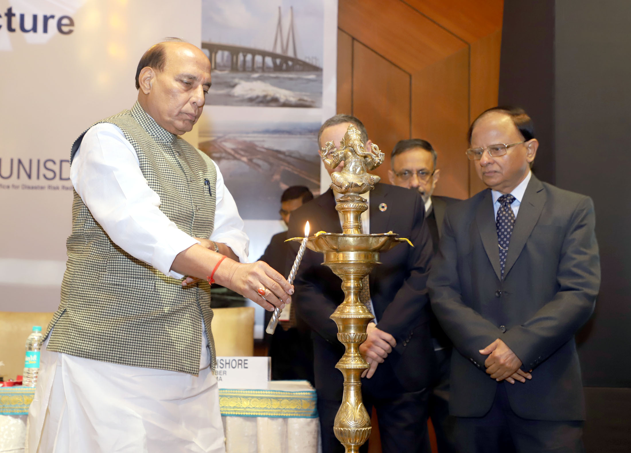 The Union Home Minister, Shri Rajnath Singh lighting the lamp to inaugurate the International Workshop on Disaster Resilient Infrastructure (IWDRI), in New Delhi on January 15, 2018. The Additional Principal Secretary to the Prime Minister, Dr. P.K. Mishra is also seen.