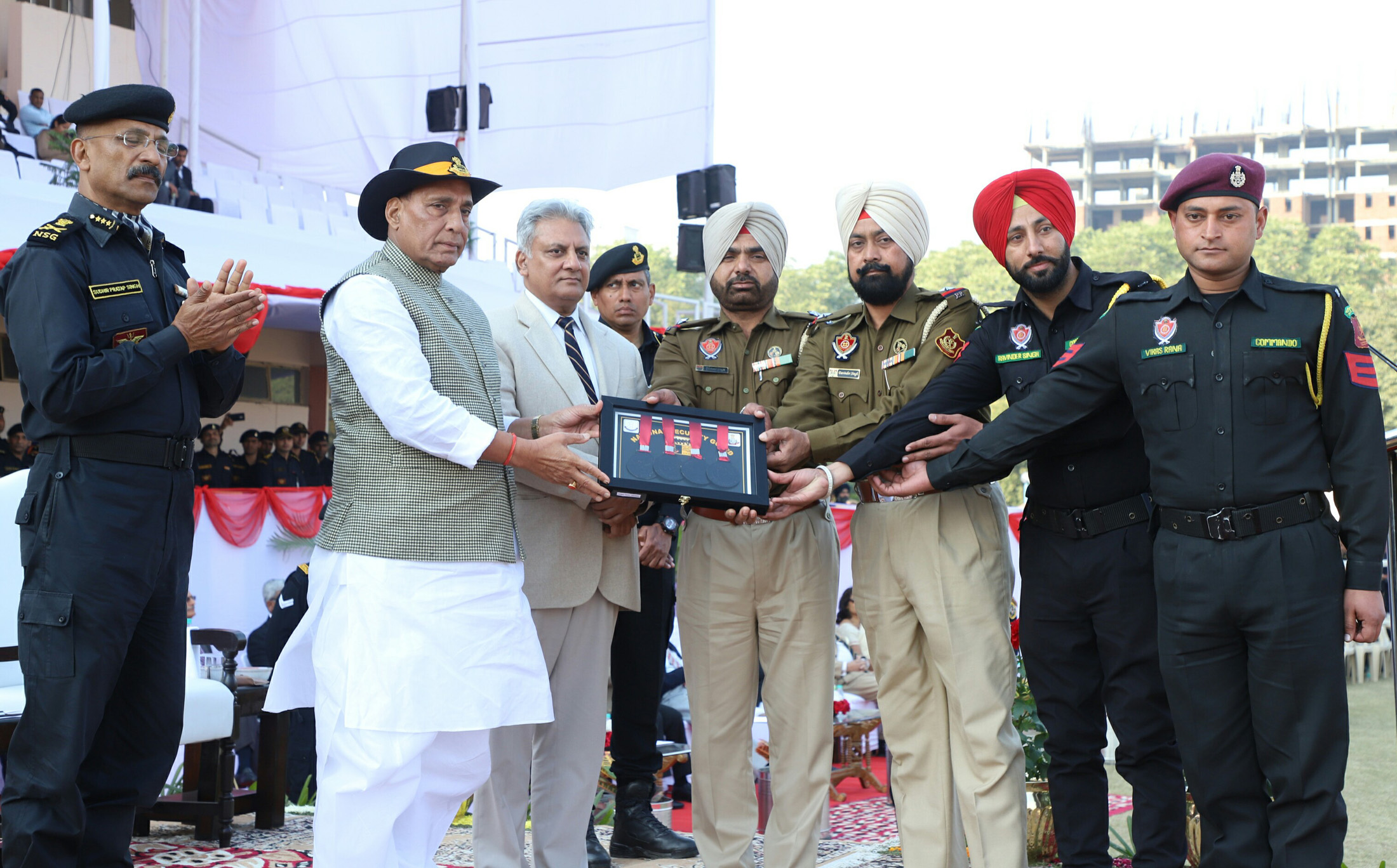 The Union Home Minister, Shri Rajnath Singh presenting the medals and trophies, during the Closing Ceremony of the 8th All India Police Commando Competition, at Manesar, Gurugram, in Haryana on January 20, 2018.  The Director General, NSG, Shri Sudhir Pratap Singh and the Director, IB, Shri Rajiv Jain are also seen.