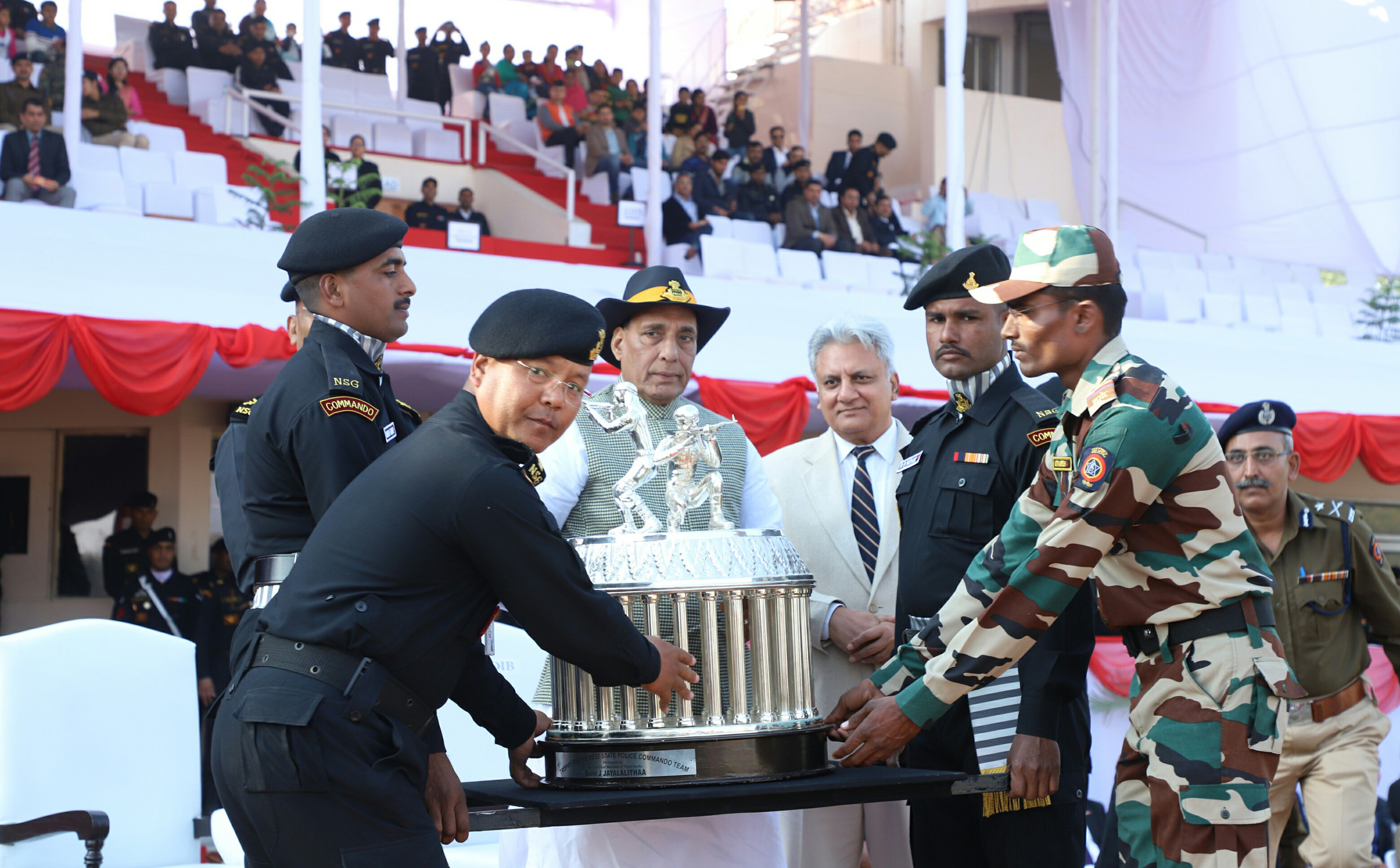 The Union Home Minister, Shri Rajnath Singh presenting the medals and trophies, during the Closing Ceremony of the 8th All India Police Commando Competition, at Manesar, Gurugram, in Haryana on January 20, 2018.  The Director, IB, Shri Rajiv Jain is also seen.