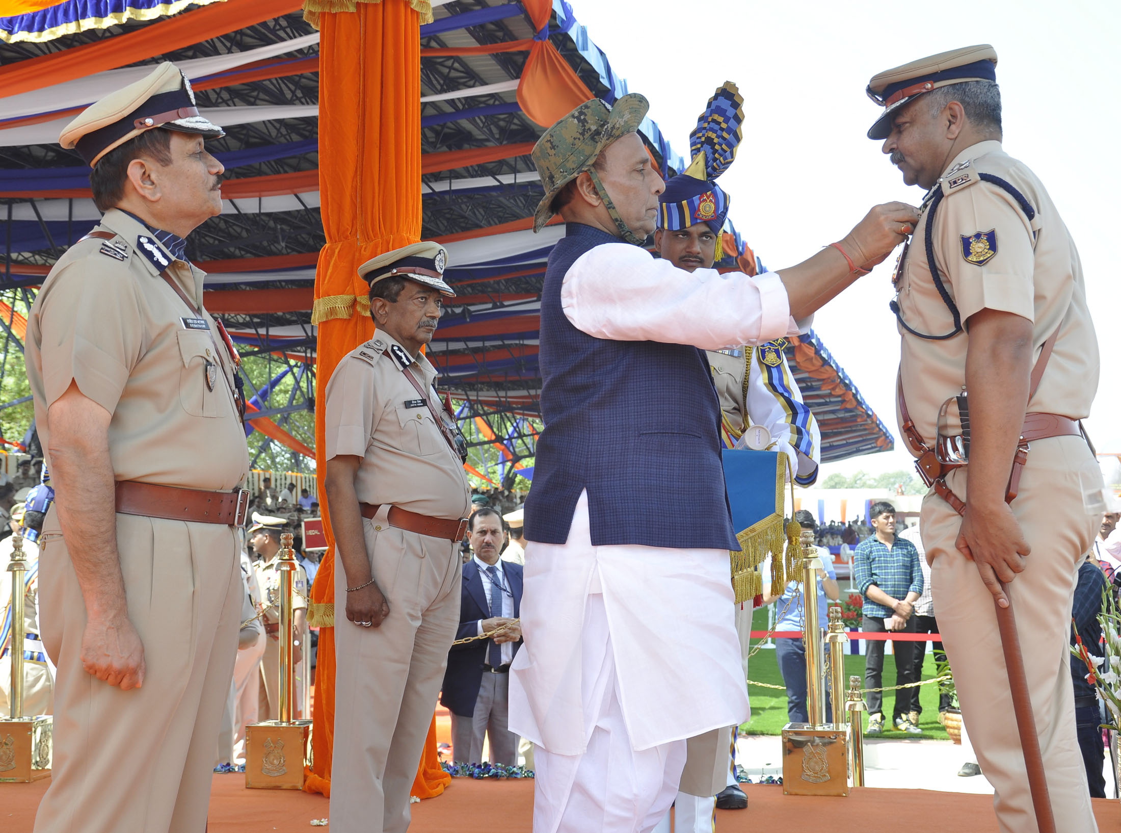 The Union Home Minister, Shri Rajnath Singh presenting President's Police Medals for Distinguished Service on the occasion of CRPF's 79th Raising Day Parade, in Gurugram, Haryana in March 24, 2018.