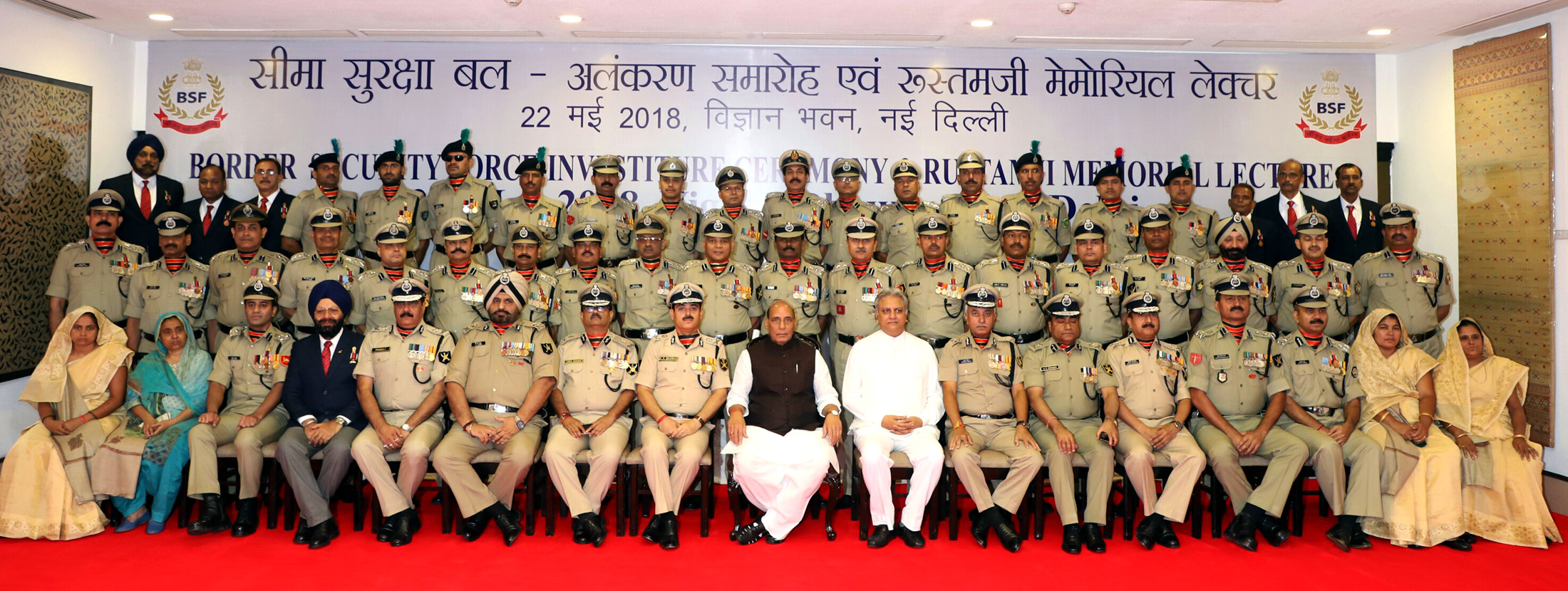 The Union Home Minister, Shri Rajnath Singh in a group photograph with the awardees, during the Investiture Ceremony of Border Security Force (BSF), in New Delhi on May 22, 2018.  The DG, BSF, Shri K.K. Sharma, the Director, IB, Shri Rajiv Jain and other dignitaries are also seen.