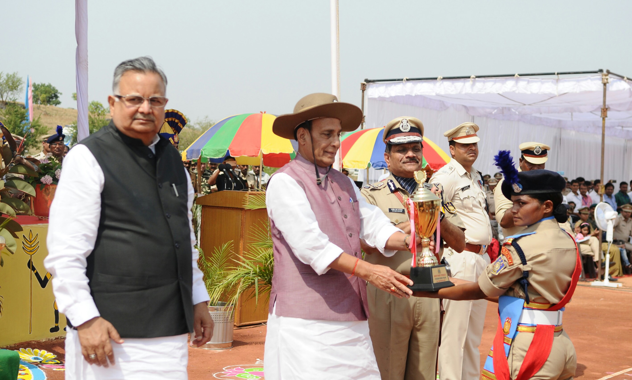 The Union Home Minister, Shri Rajnath Singh presenting trophies, during the Passing Out Parade of the 'Bastariya Battalion' of CRPF, in Ambikapur, in Chhattisgarh on May 21, 2018. 	The Chief Minister of Chhattisgarh, Dr. Raman Singh is are also see