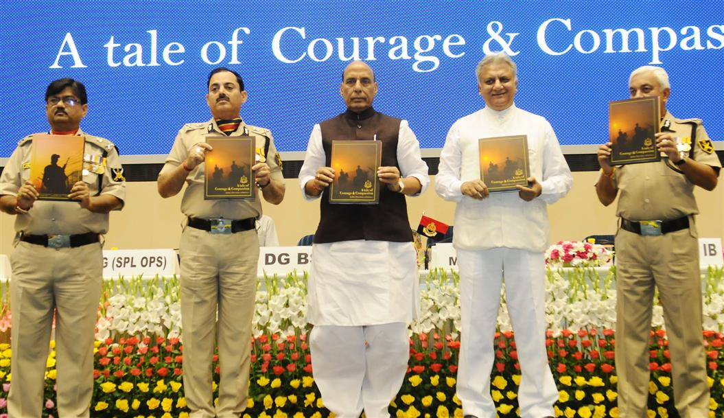 Shri Rajnath Singh releasing the coffee table book titled 'A tale of Courage & Compassion', at the Investiture Ceremony of Border Security Force (BSF), in New Delhi